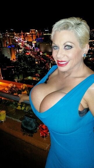 big tits over the strip