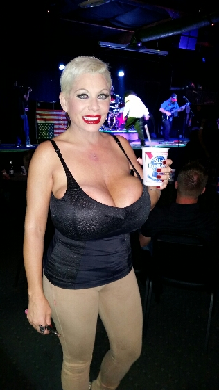 Claudia Marie drinking and partying with huge fake tits