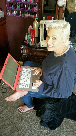 claudia marie surfing the web on her laptop computer with huge boobs