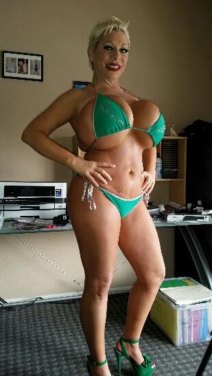 Claudia Marie big fake tits and fat ass in green bikini