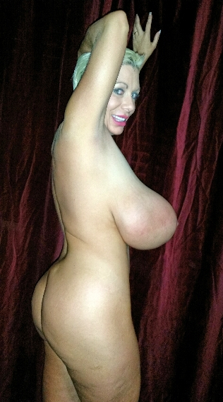 Silicone udders on a whore with a big round ass