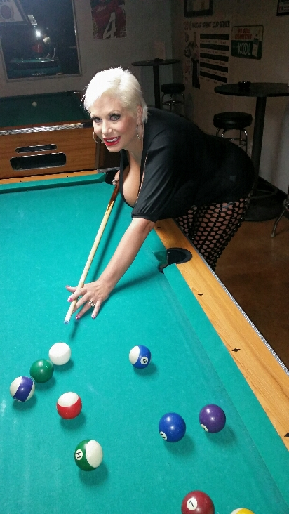 Big tit whore Claudia Marie shooting a game of pool