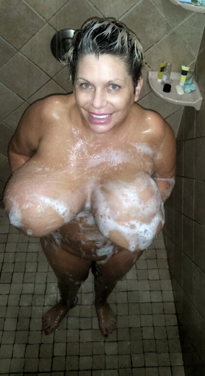 Claudia Marie holding up her saggy jugs