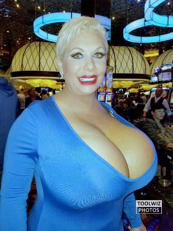 Giant fake tits in a tight blue dress